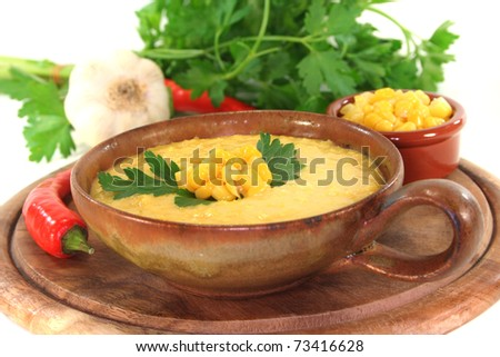 Corn soup with garlic, sweet corn, chili and coriander