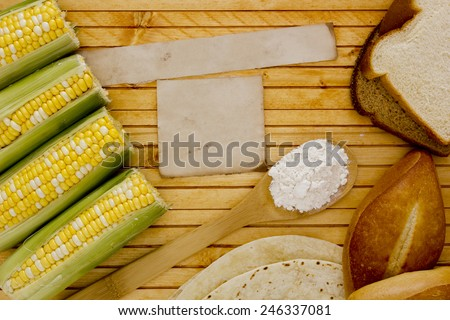 Corn starch with corn on the cob and bread. - stock photo