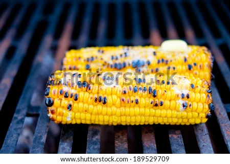 Corn topped with butter on the grill - stock photo