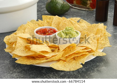 Corn tortilla chips with salsa and guacamole - stock photo