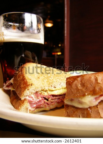 Corned Beef Sandwich and a Pint of Dark Beer - stock photo
