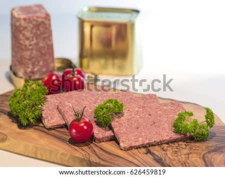 Corned Beef With Tomato And Parsley On Wood