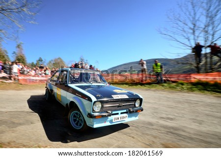 CORNELLANA, SAPIN - MAR 8: Belgian driver Cristophe Demortier and his codriver Isabelle Henry in a Ford Escort RS2000 Mk II race in the 6th Solo Escort, on Mar 8, 2014 in Asturias, Spain. - stock photo