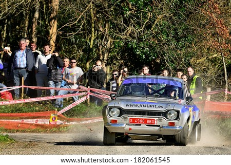 CORNELLANA, SAPIN - MAR 8: Spanish driver Carles Palou and his codriver Miky Iba�±ez in a Ford Escort RS2000 Mk I race in the 6th Solo Escort, on Mar 8, 2014 in Asturias, Spain. - stock photo