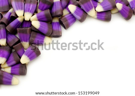 Corner border of purple and black Halloween candy corn - stock photo