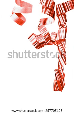 Corner Border of Striped Red Curly Hanging Party Streamers isolated on white background - stock photo