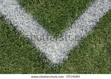 Corner boundary line of a green sports field (football, soccer, baseball, rugby, cricket etc…) - stock photo