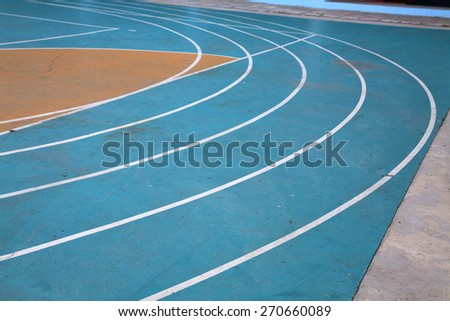 Corner curve of blue running track: Sport symbol - stock photo
