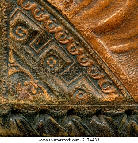 Corner detail of antique leather book cover