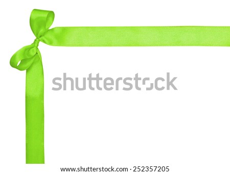 Corner for text, made of a green ribbon and a bow on the white - stock photo