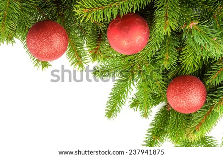 corner made of green christmas tree branches and red balls - stock photo