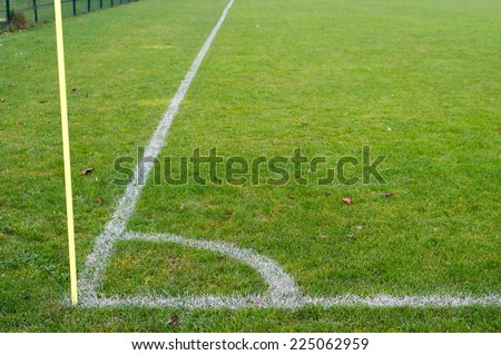 Corner marking on a grass covered soccer field.