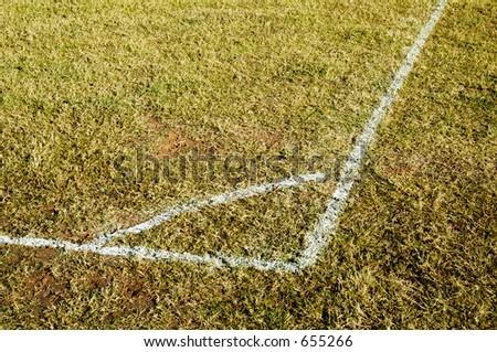 Corner markings on a soccer field. - stock photo