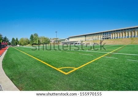 Corner marks of a soccer, football field in a bright sunny day.