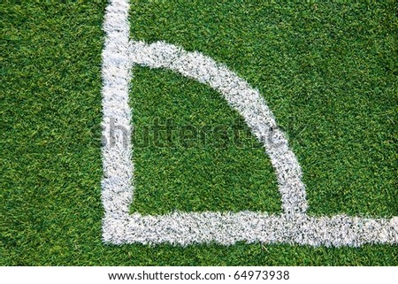 Corner of a football (soccer) field is made from synthetic lawn
