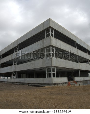 Corner of a new office building constructed out of steel using a fast paced construction process - stock photo