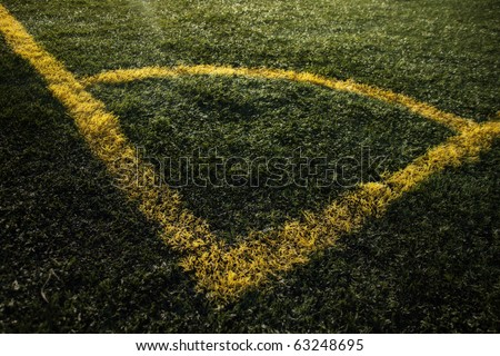 Corner of a soccer field with dramatic lighting. - stock photo