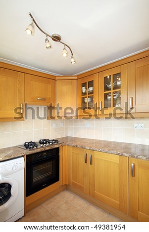 Corner of Beech kitchen units in UK home