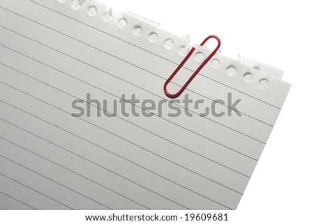 Corner of blank note paper with red paper-clip. Isolated on white. Clipping path. - stock photo