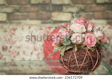 Corner of cozy living room artificial flowers for decoration , Vintage style - stock photo