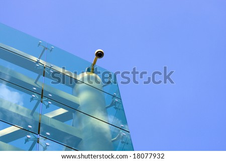 Corner of glass faced office building - stock photo