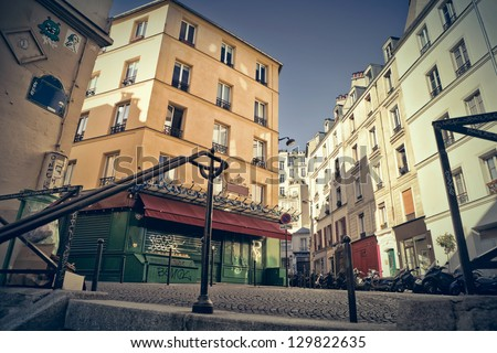 """Corner of little streets in Montmartre, Paris, seen from the top of a typical staircase. This was the set of the movie """"Amelie Poulain"""". - stock photo"""