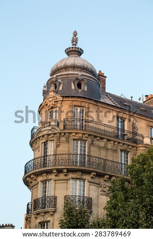 corner of of typical house with balcony in Paris, France  - stock photo