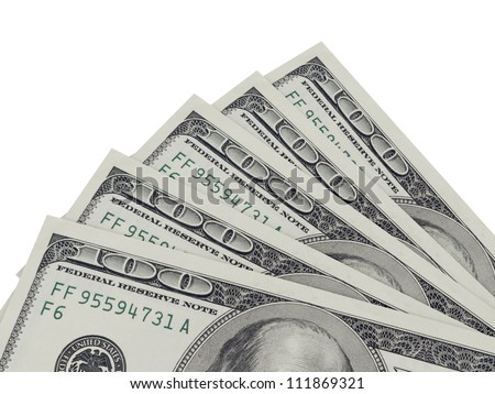 Corner of one hundred dollar bills, isolated on white.