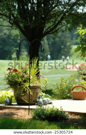 Corner of outdoor patio with golf course in background. Sunny summer day. - stock photo