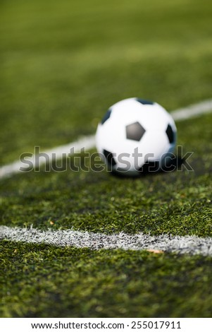 Corner of penalty area of artificial green soccer turf. - stock photo