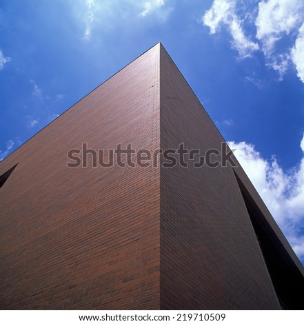 Corner of the building against a blue sky. - stock photo