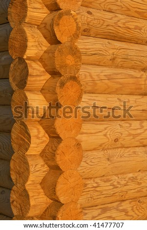 Corner of the house constructed of logs in decline beams