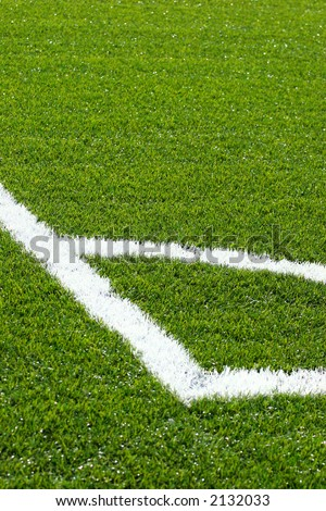 Corner on football/soccer pitch with green artificial grass - stock photo