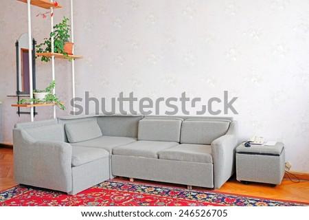 Corner sofa in a motel room - stock photo