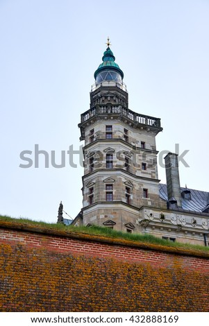 Corner tower of Elsinore castle in Denmark, with a lighthouse on the top