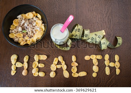 cornflakes and yogurt on a wooden table. Dietary breakfast - stock photo