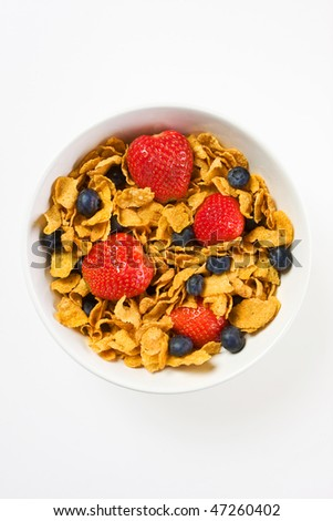 Cornflakes cereal with strawberries and blueberries in a white bowl isolated over white, great for healthy diet concept