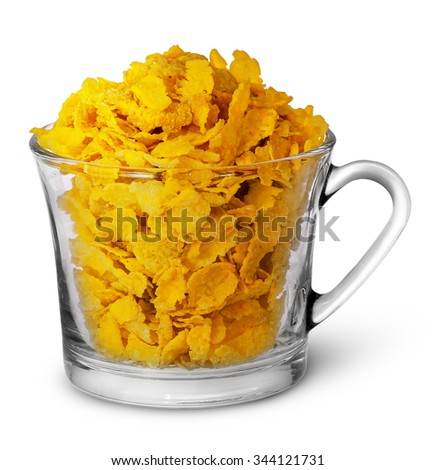 Cornflakes in a glass cup isolated on white background - stock photo