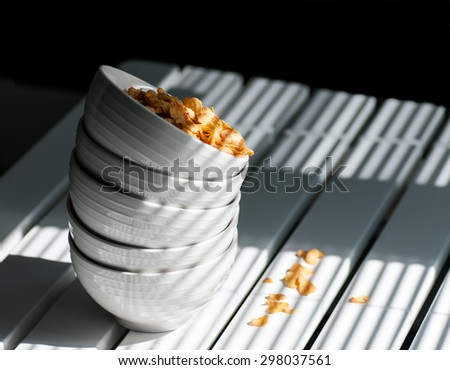 cornflakes in a plate on the table - stock photo