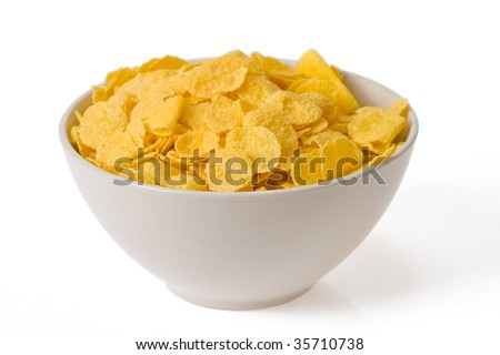 cornflakes in bowl on white background - stock photo