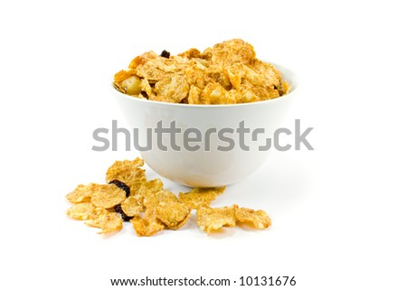 cornflakes in bowl over white background