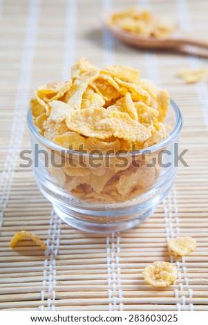 Cornflakes on bamboo background  - stock photo