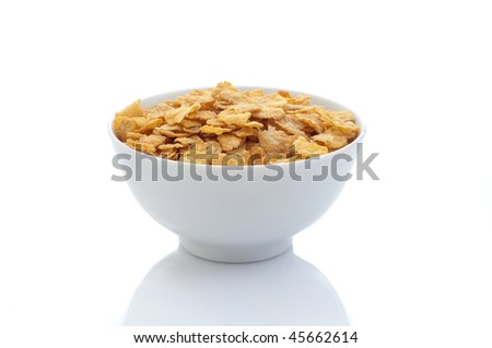 cornflakes on white - stock photo