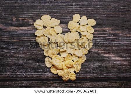 cornflakes on wood background - stock photo