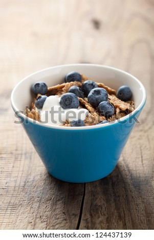 cornflakes with blueberry and yogurt - stock photo