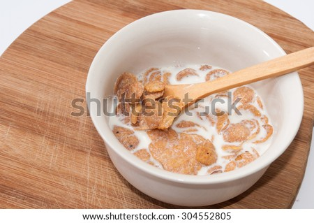 Cornflakes with milk in the white bowl. - stock photo