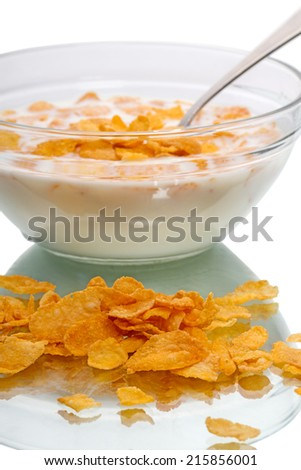 Cornflakes with milk isolated on white background - stock photo