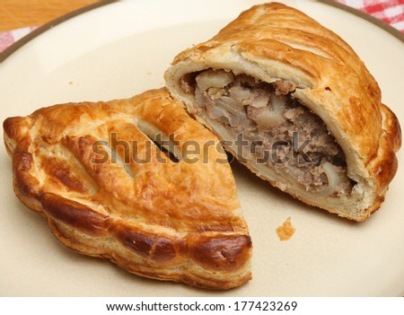 Cornish pastie filled with meat and vegetables - stock photo