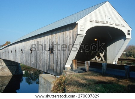 Cornish-Windsor covered bridge (world's longest covered bridge at 460 feet and built in 1860) connecting New Hampshire and Vermont - stock photo