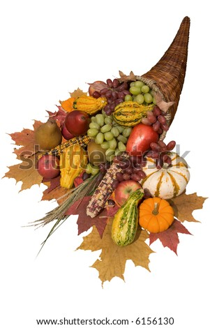 Cornucopia filled with fall harvest spilling out of it's horn of plenty - stock photo